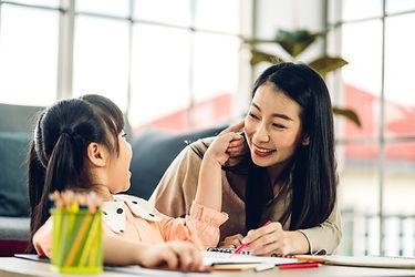 parent helping child do homework.jpg