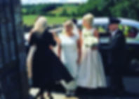Yvonne topping up her bride before shesings her up the aisle