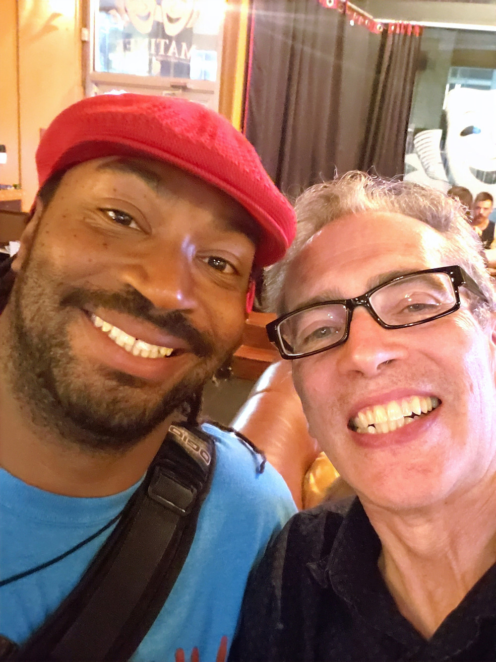 two men smile for the camera in a selfie