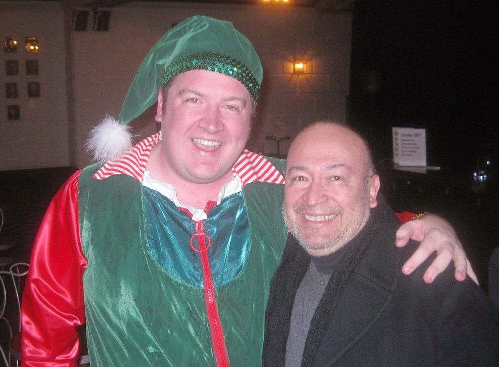 Kevin Kennedy in an elf costume with Javier