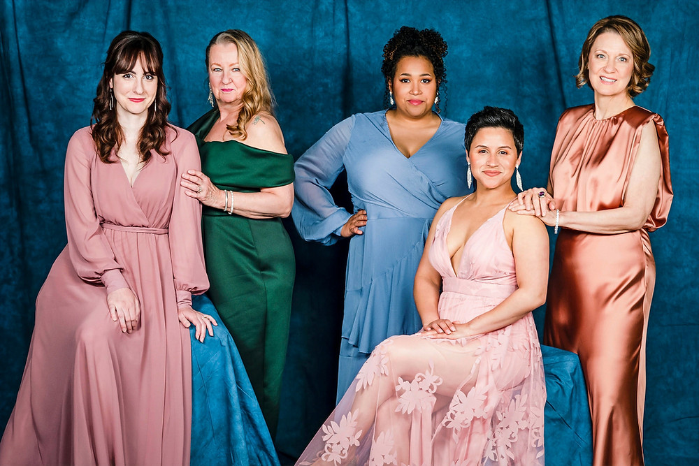 five women in evening gowns