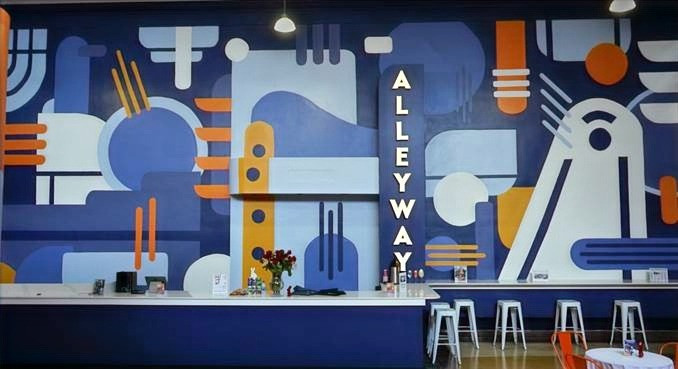 a mural on a wall with colorful geometric shapes
