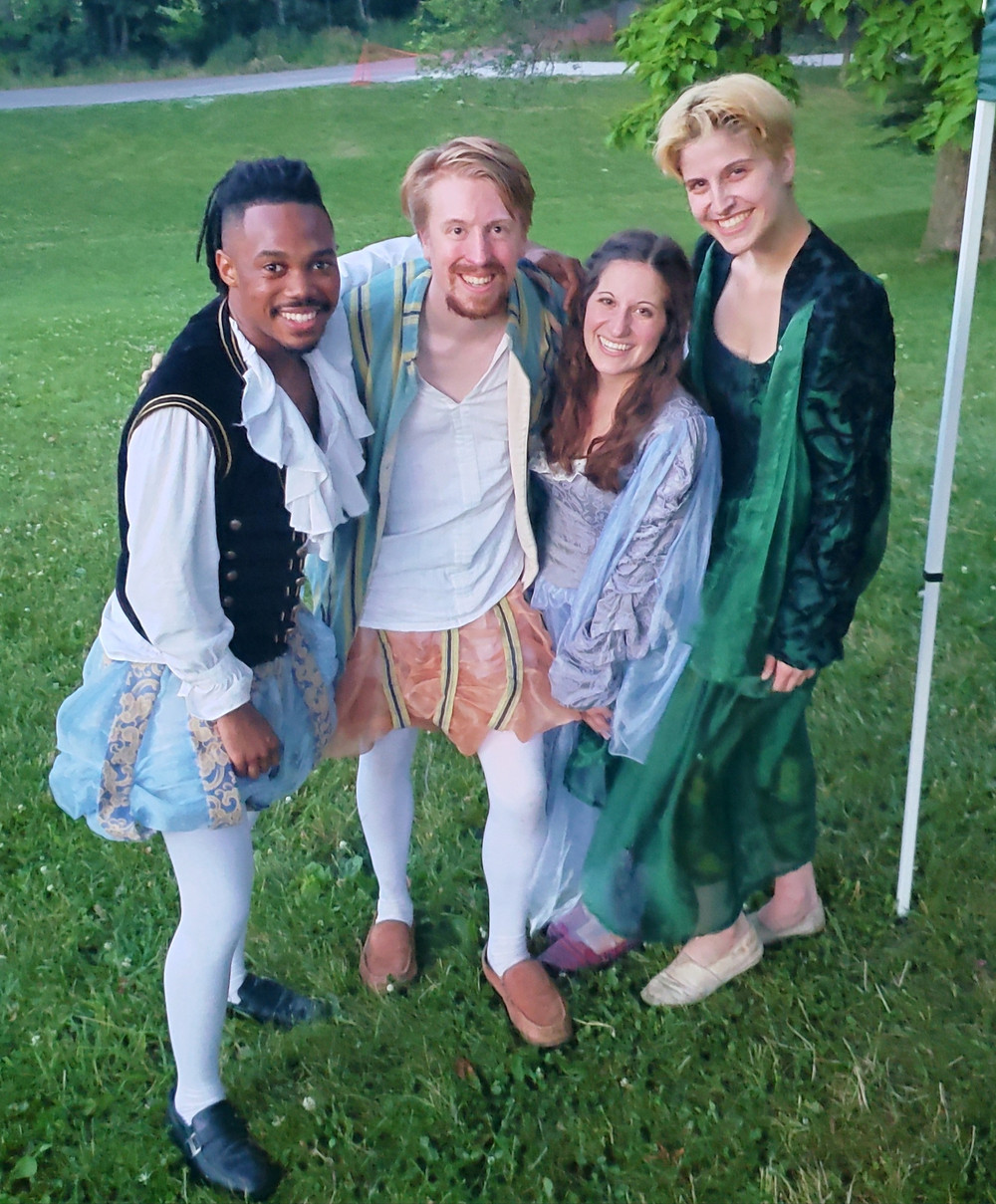 four young actors in Elizabethan clothes