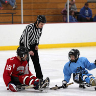 wisconsin-skeeters-sled-hockey-face-off.
