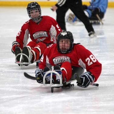 sled-hockey-adaptive-sports-having-fun.j