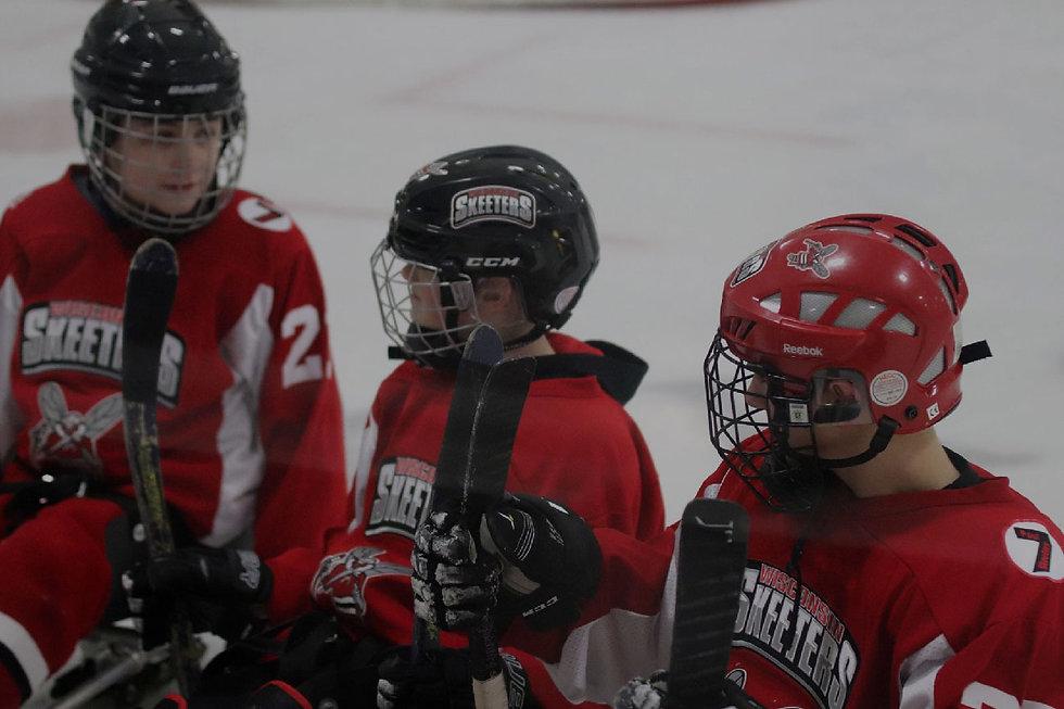 Sled-hockey-team-bonding-with-overlay.jp