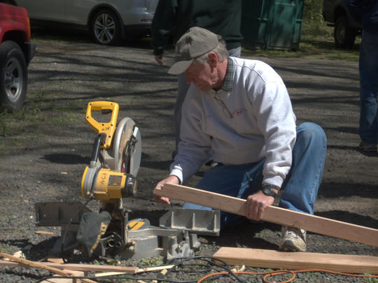12.Professional Carpenters cutting new w