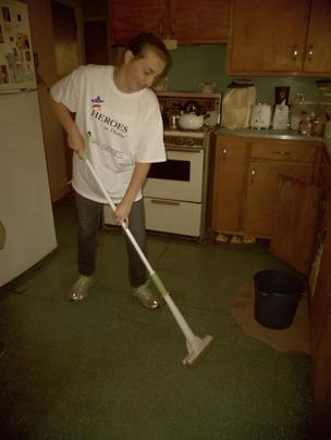 14.Volunteer working on the kitchen clea