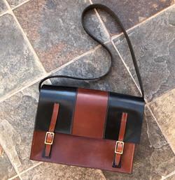 Conker and black satchel bag