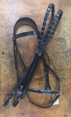 Drop Noseband Bridle with laced rein featuring fancy stitching.