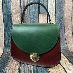 Green and maroon grab handle bag