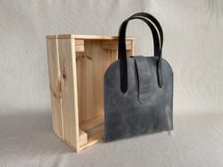 Grey over arm minimalist bag