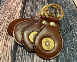Sedgwicks conker leather keyrings featuring used shot shell caps.