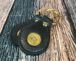 Sedgwicks black leather keyrings featuring used shot shell caps