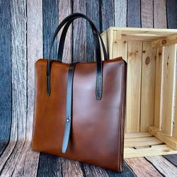 Slimline laptop bag in Sedgwicks whiskey tan leather