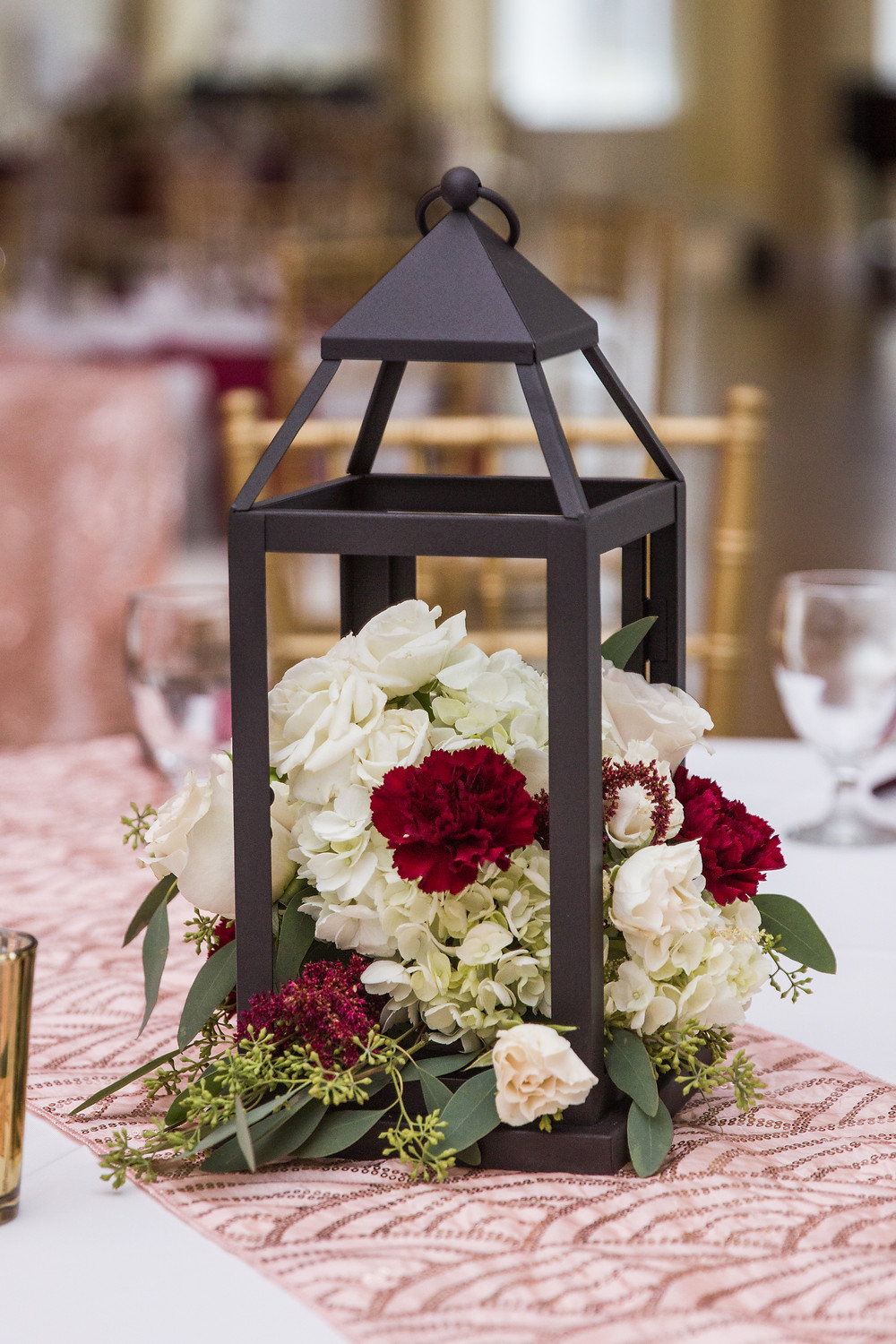 wedding, reception, tablescape, lantern, floral arrangements, burgundy, white, light pink, seeded eucalyptus, wedding day, columbia, mo, blue diamond events photography, fall colors, Kimball Ballroom, Stephens College, fall decor, blue diamond events coordinating, day of coordinating