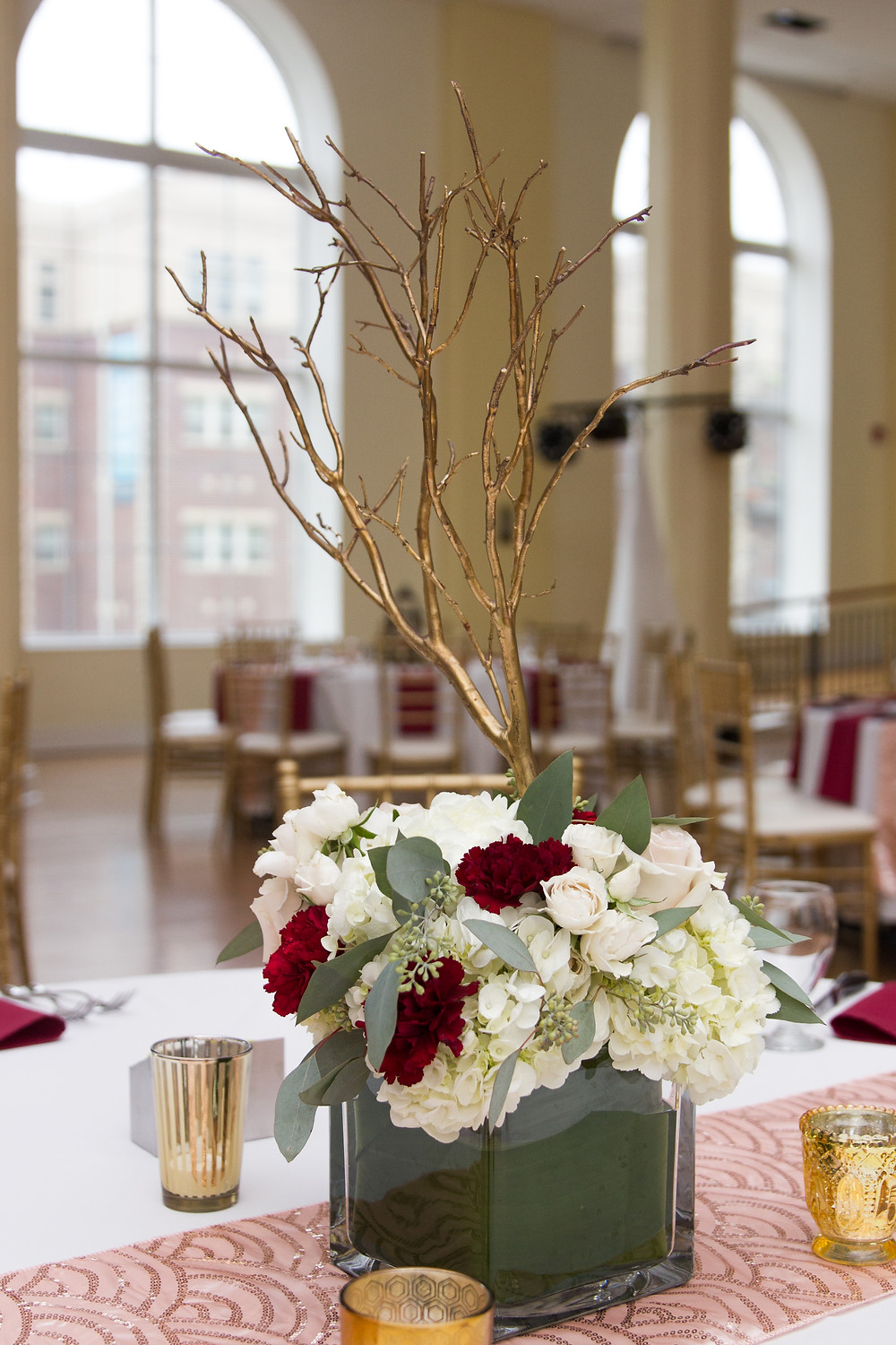 wedding, reception, tablescape, manzanita branches, gold, floral arrangements, burgundy, white, light pink, seeded eucalyptus, wedding day, columbia, mo, blue diamond events photography, fall colors, Kimball Ballroom, Stephens College, fall decor, blue diamond events coordinating, day of coordinating