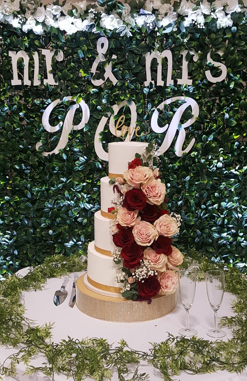 greenery wall, wedding cake, columbia mo, wedding, dj, decor, flowers, blue diamond events, photo booth, backdrop, leaves, mr and mrs