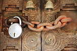 chain and padlock across ornate carved door
