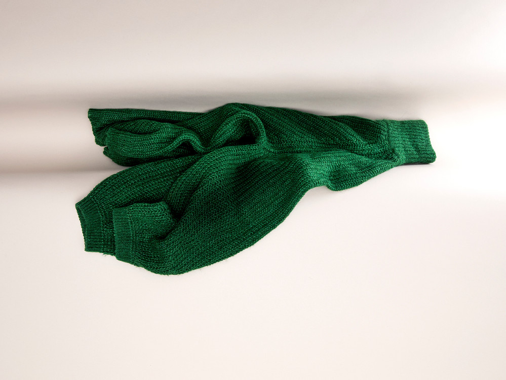 Green Knitted Jumper in Fold