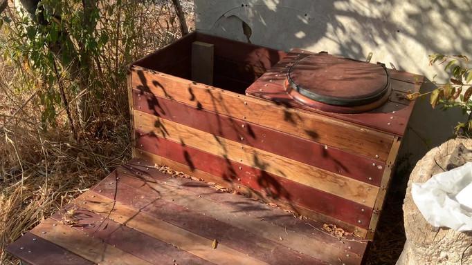Outdoor compost bin toilet