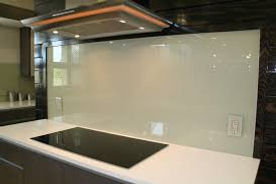 white glass backsplash.jpg