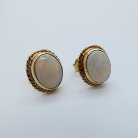SOLD Yellow gold and Opal Studs £375.00