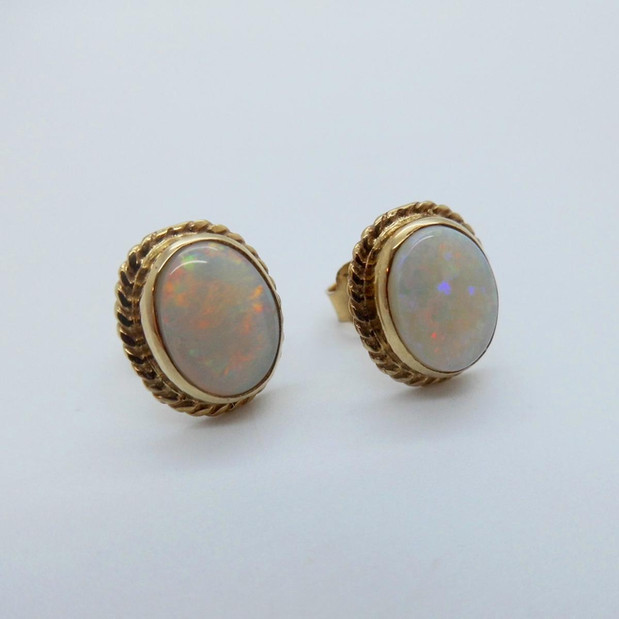 Yellow gold and Opal Studs £375.00