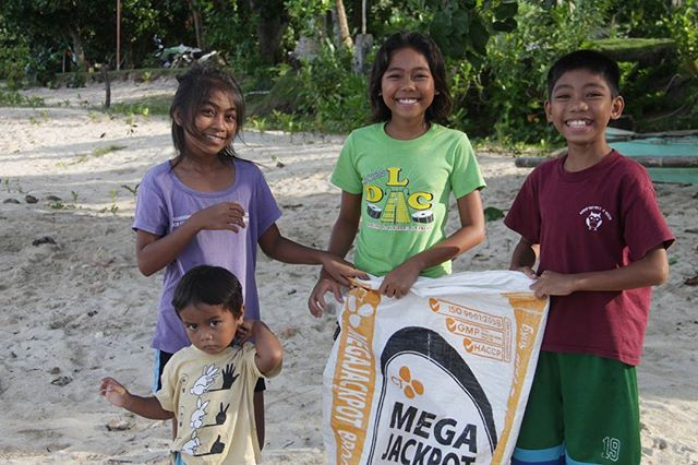 Rico, Reanne, Naizel and Bren can't hold back their smiles during the beach clean up! The older kids