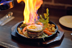 Try one of our Flaming Steaks!