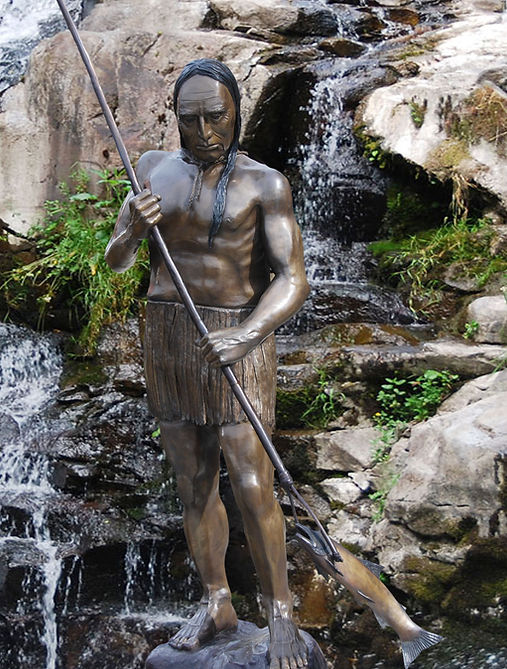 Sculpture of Indian spearing fish.