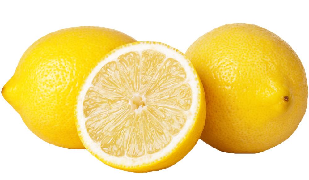 Tre citroner med vit bakgrund