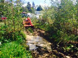 Wa'Gosh digging out a pond!