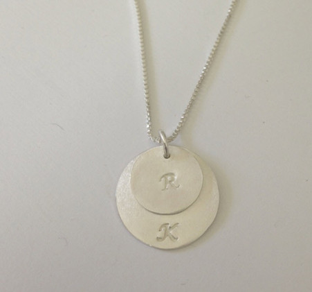 Two sterling silver initial pendants