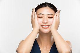 A woman is massaging her face..jpg