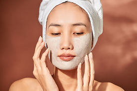 Young beautiful woman with clay face mask. Spa treatment, self care and healthy skin.jpg