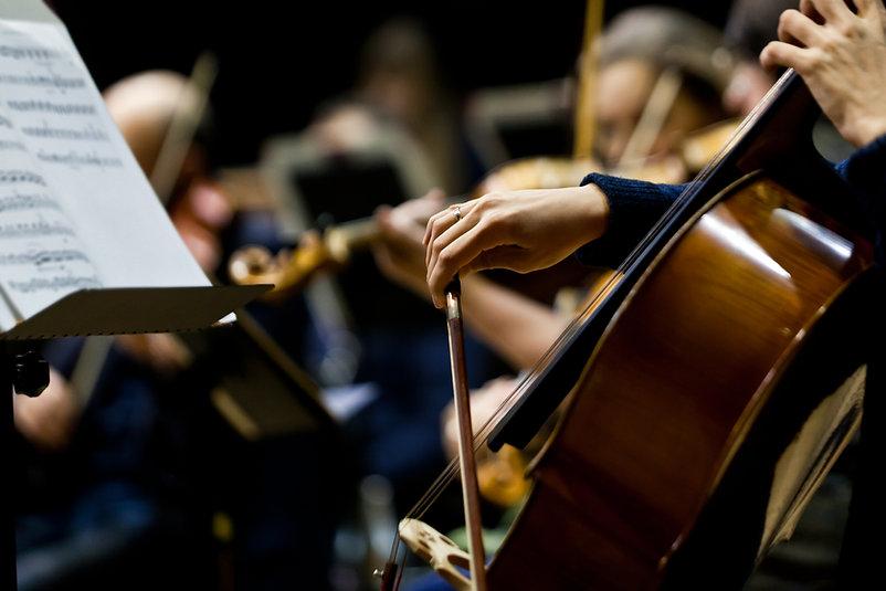 Hand girl playing cello closeup .jpg