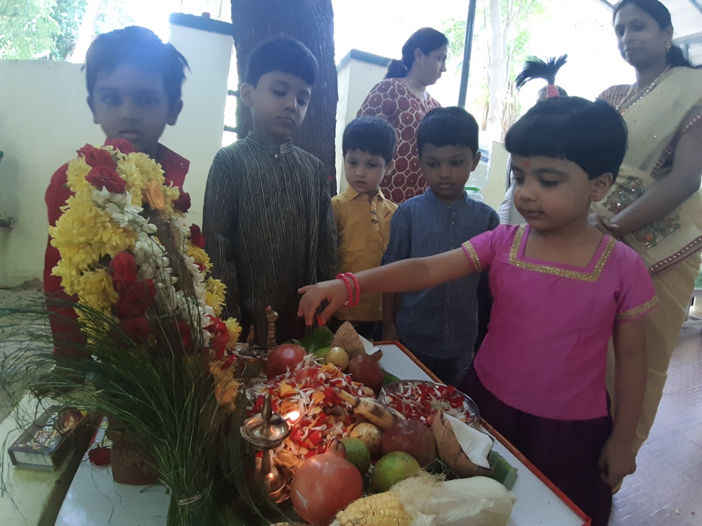 Offering flowers to Lord Ganesha (2)