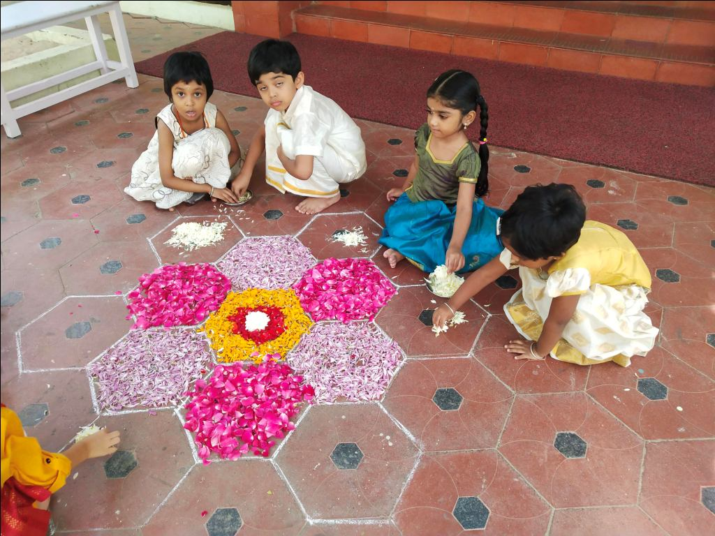 Children at work with the Pookolam