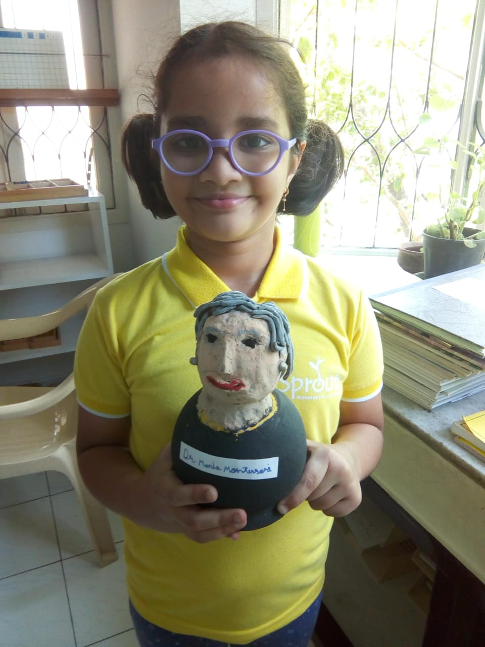 Madhu displaying a model of Dr