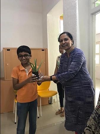 Smita ma_am giving away herbal saplings.