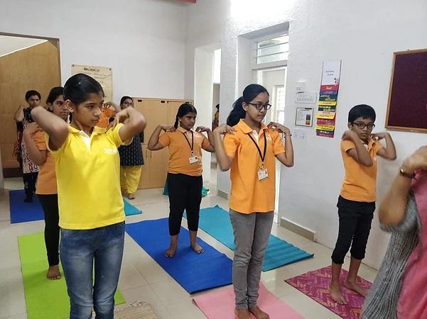 Practicing a few asanas on World Yoga Da