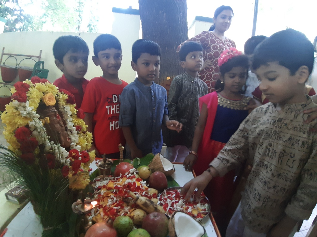 Offering flowers to Lord Ganesha