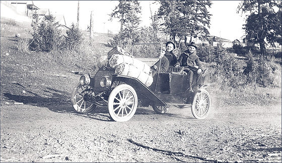 Vintage Photo of a Man And Woman Driving Old Car_edited.jpg