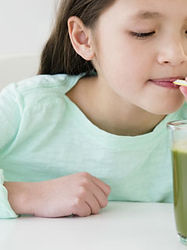 child-drinking-green-smoothie.jpg