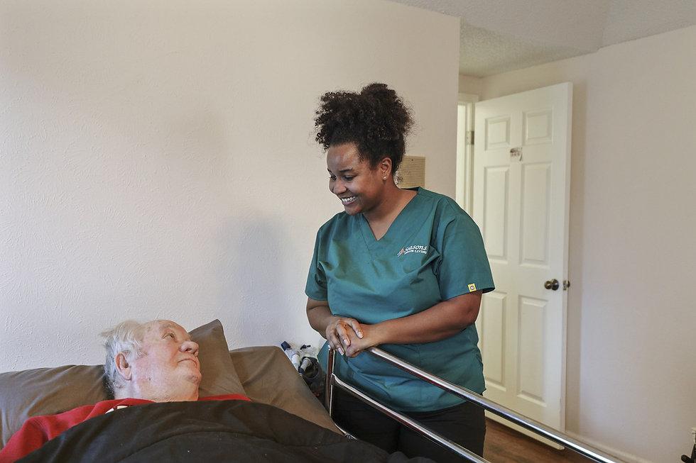 Caregiver with bedbound senior | Assisted Living | 4 Seasons Senior Living