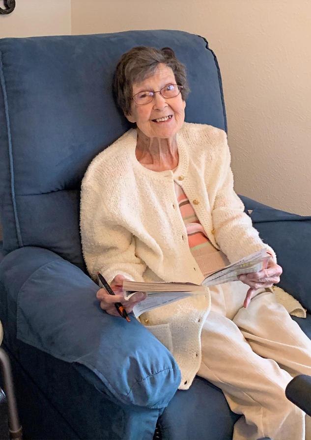 Senior resident reading | 4 seasons senior living