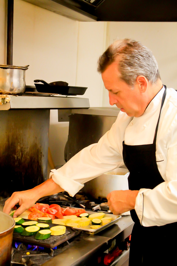 4 seasons chef preparing mixed vegtables
