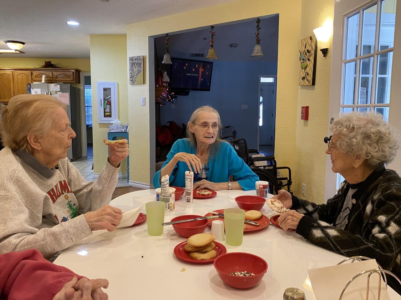Seniors decorating cookies