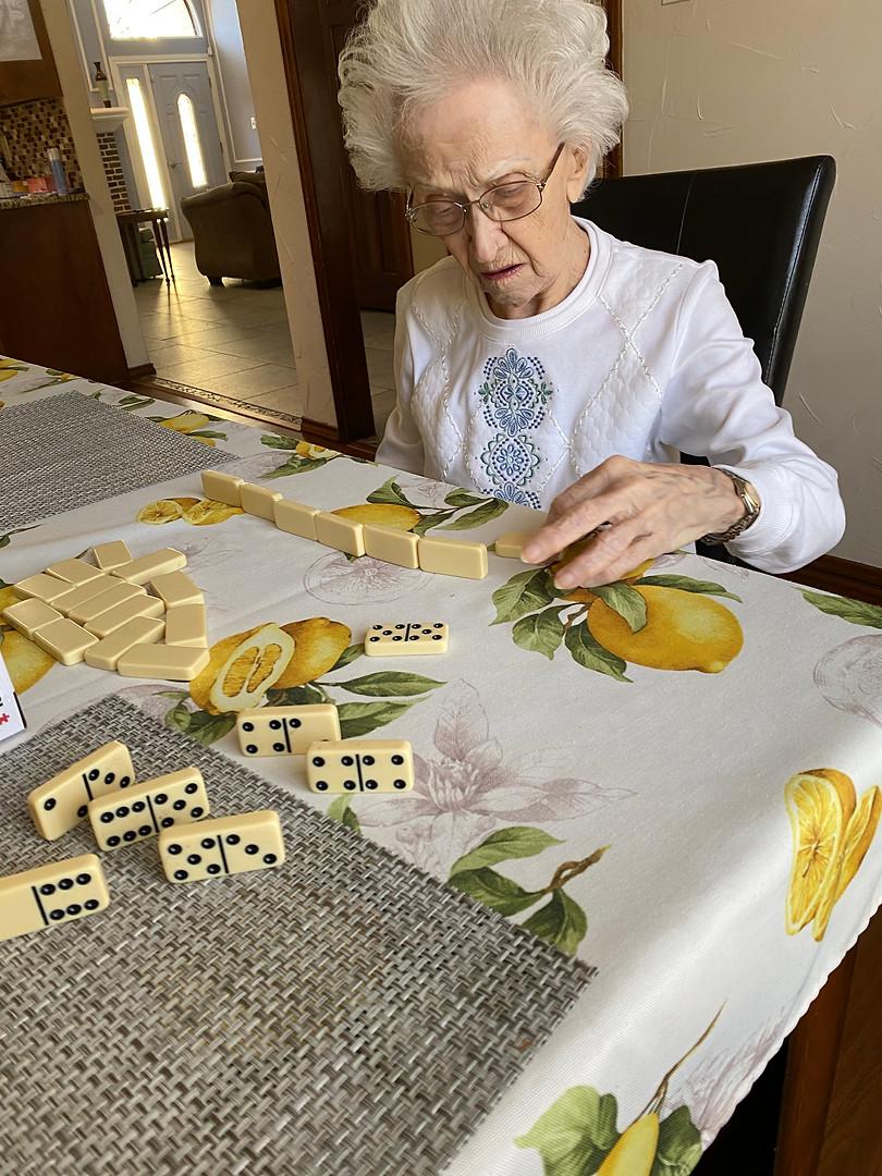 Senior playing dominoes
